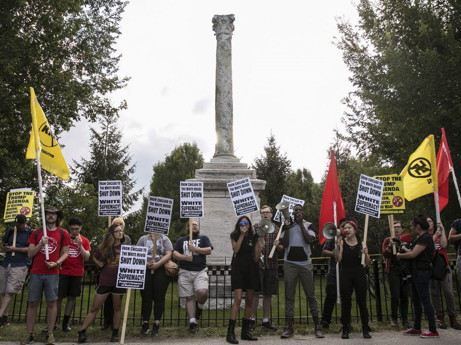 Dozens protest and call for the removal of the Balbo monument, given to Chicago in 1933 by fascist Italian dictator Benito Mussolini, in Burnham Park, Wednesday night, Aug. 23, 2017. File Photo.   Ashlee Rezin/Sun-Times