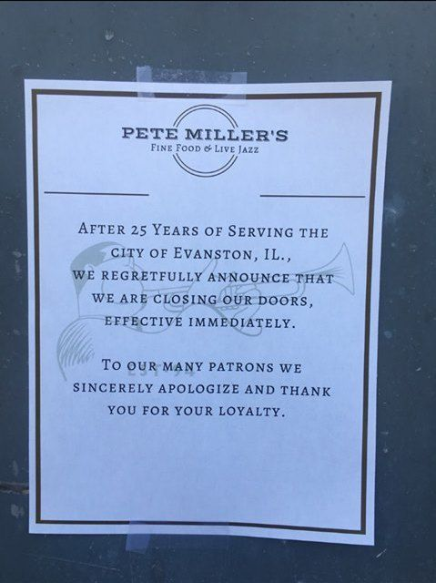 """A paper sign taped to a window reads, """"After 25 years of serving the city of Evanston, Illinois, we regretfully announce that we are closing our doors effective immediately. To our many patrons we sincerely apologize and thank you for your loyalty."""""""