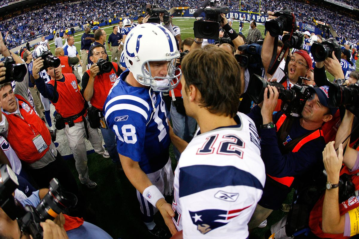 Peyton Manning of the Indianapolis Colts meets with Tom Brady of the New England Patriots following the game at the RCA Dome November 4, 2007 in Indianapolis, Indiana.