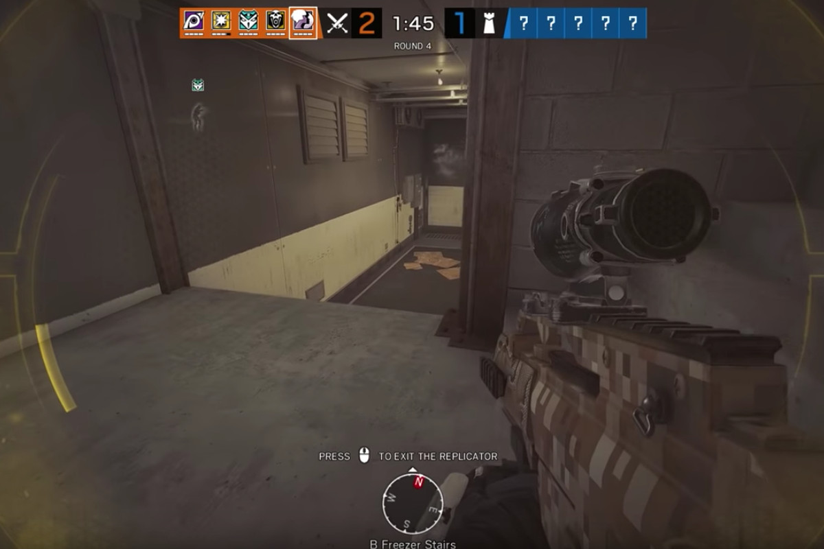 A first-person view of a player, weapon drawn, moving along a staircase in Rainbow Six Siege
