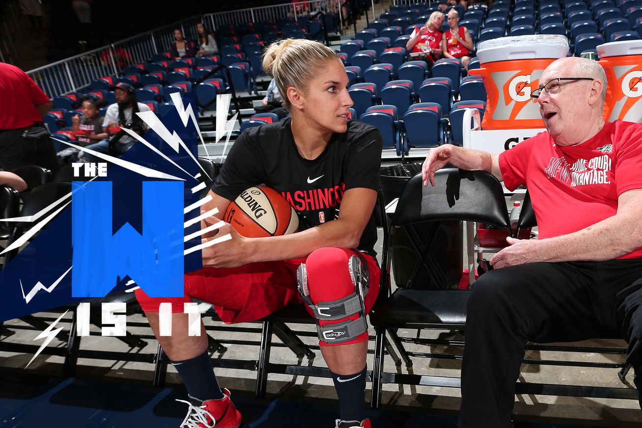 Elena Delle Donne looks at Mike Thibault while sitting in chairs on the bench.