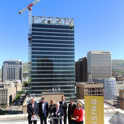 W. James Tozer Jr., managing director of Vectra Management Group, joins other local business leaders and elected officials from atop the Walker Center in Salt Lake City on Tuesday, May 3, 2016. The group was there to discuss Downtown Rising projects and its priorities for the next 10 years.