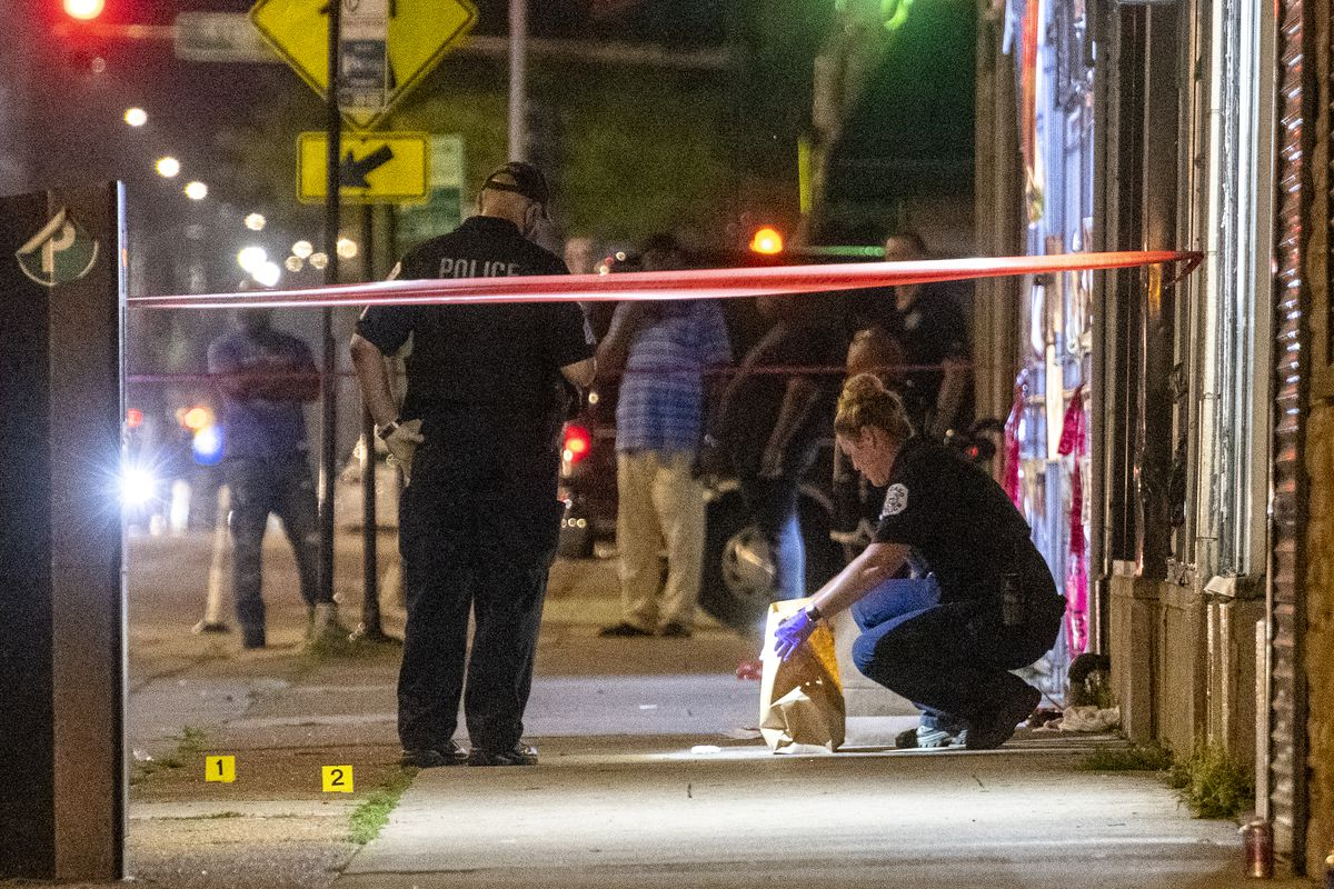 Chicago police work the scene where a 44-year-old man was shot and killed in the 500 block of East 79th Street, in the Chatham neighborhood, Saturday, July 24, 2021.