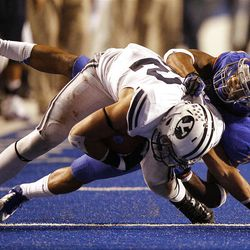 Michael Alisa of the Brigham Young Cougars is tackled by Jamar Taylor of the Boise State Broncos during NCAA football in Boise, Thursday, Sept. 20, 2012.