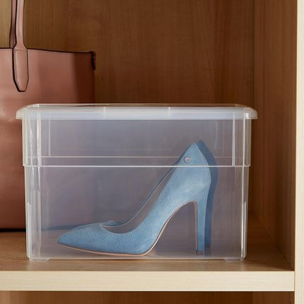 Clear lidded box with a pair of blue high heels inside.