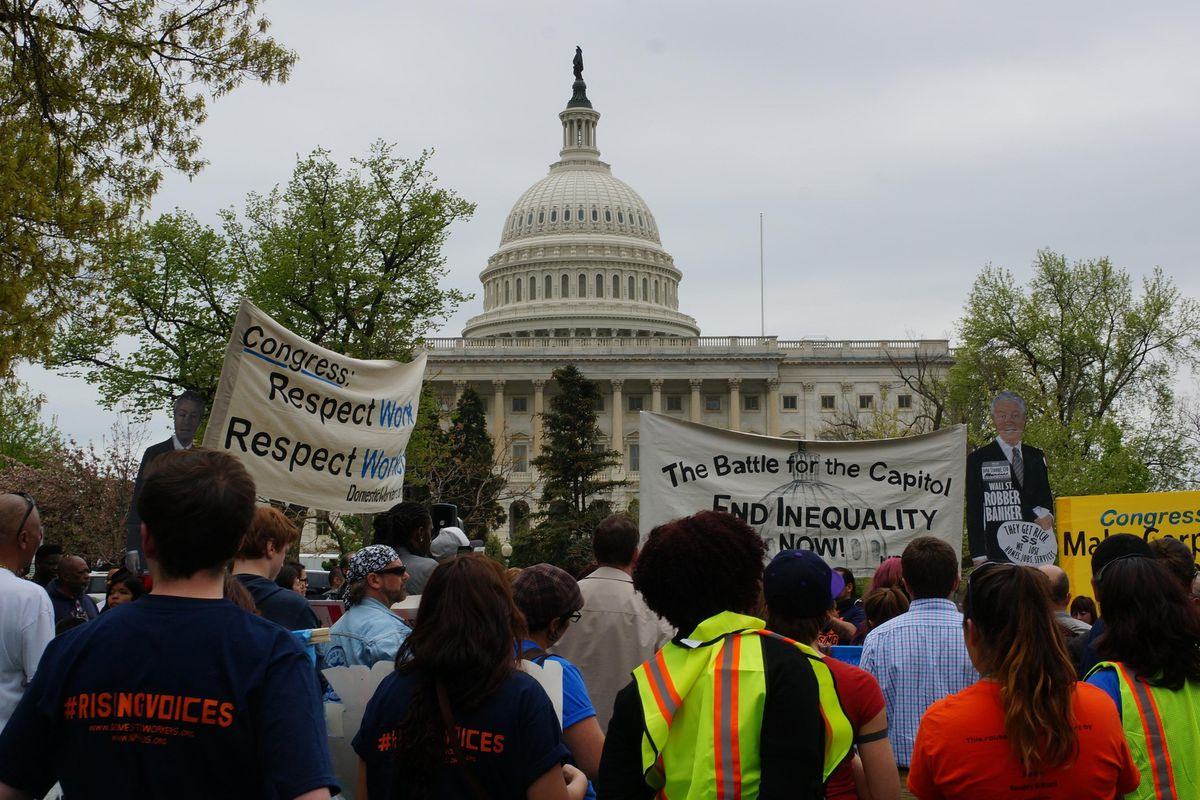 Protesters demonstrate outside the Capitol