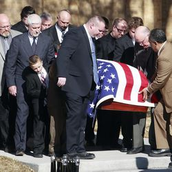 The two caskets are carried out of the chapel after the funeral services. Family and friends of Leroy Woody Fullwood and Ann Fullwood gather to remember them Friday, Jan. 6, 2012, at a funeral in Mt. Pleasant Utah. The Fullwoods were found shot dead in their home. It is believed that that they were killed by Logan McFarland and Angela Marie Hill on a multistate crime spree.