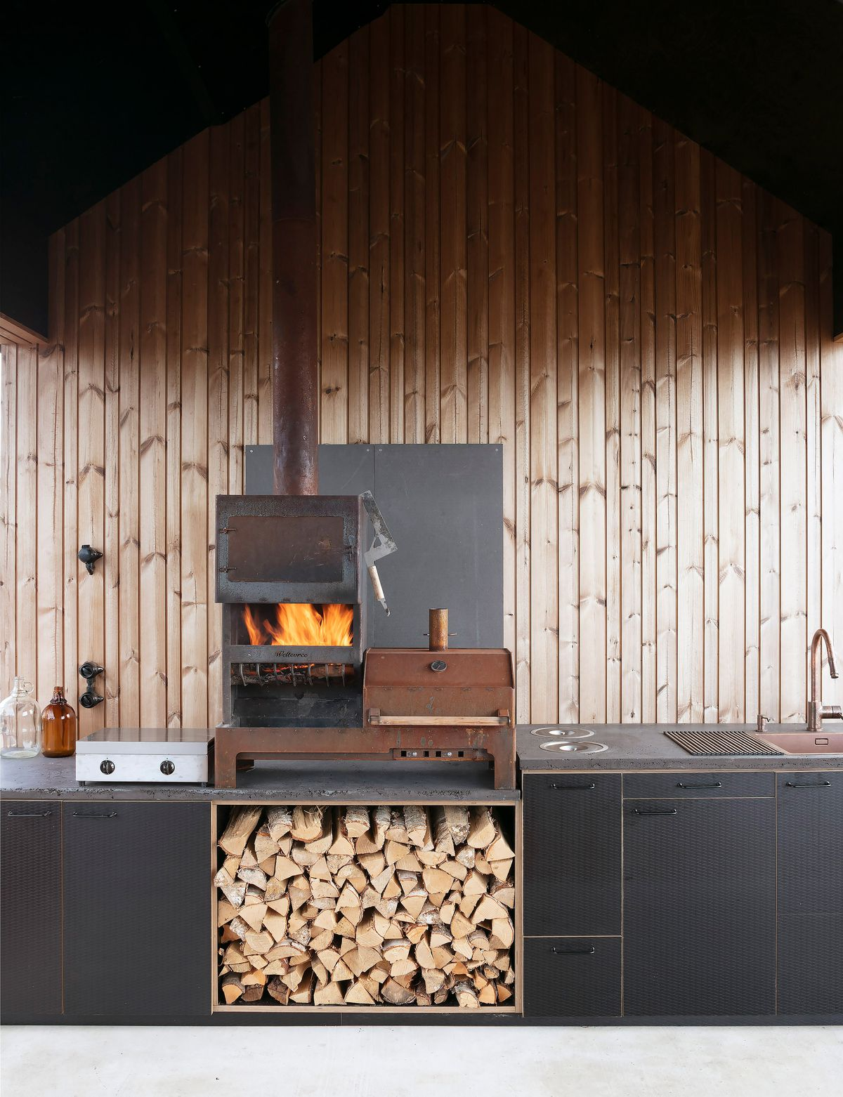 Pile of wood in modern kitchen.