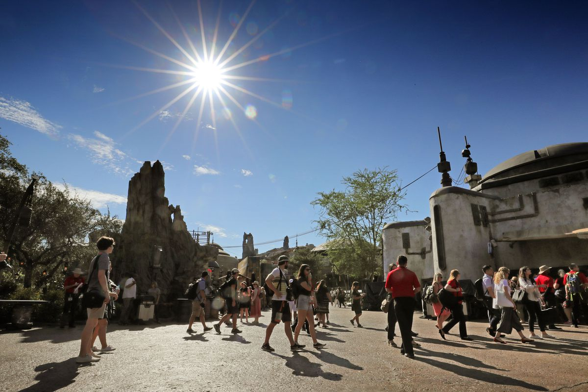 Invited guests check out Black Spire Outpost during a sneak peek of the Star Wars: Galaxy's Edge attraction at Disney's Hollywood Studios in Lake Buena Vista, Fla., Tuesday, August 27, 2019. The Star Wars themed land at Disney World officially opens on Thursday.