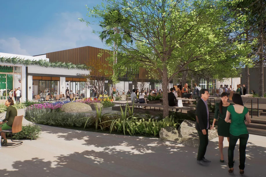 A rendering of the Sportsmen's Lodge redevelopment. There is a courtyard with people, trees, tables, and chairs in the foreground. In the background are a row of shops and restaurants.