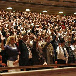 Conferencegoers sustain President Monson.