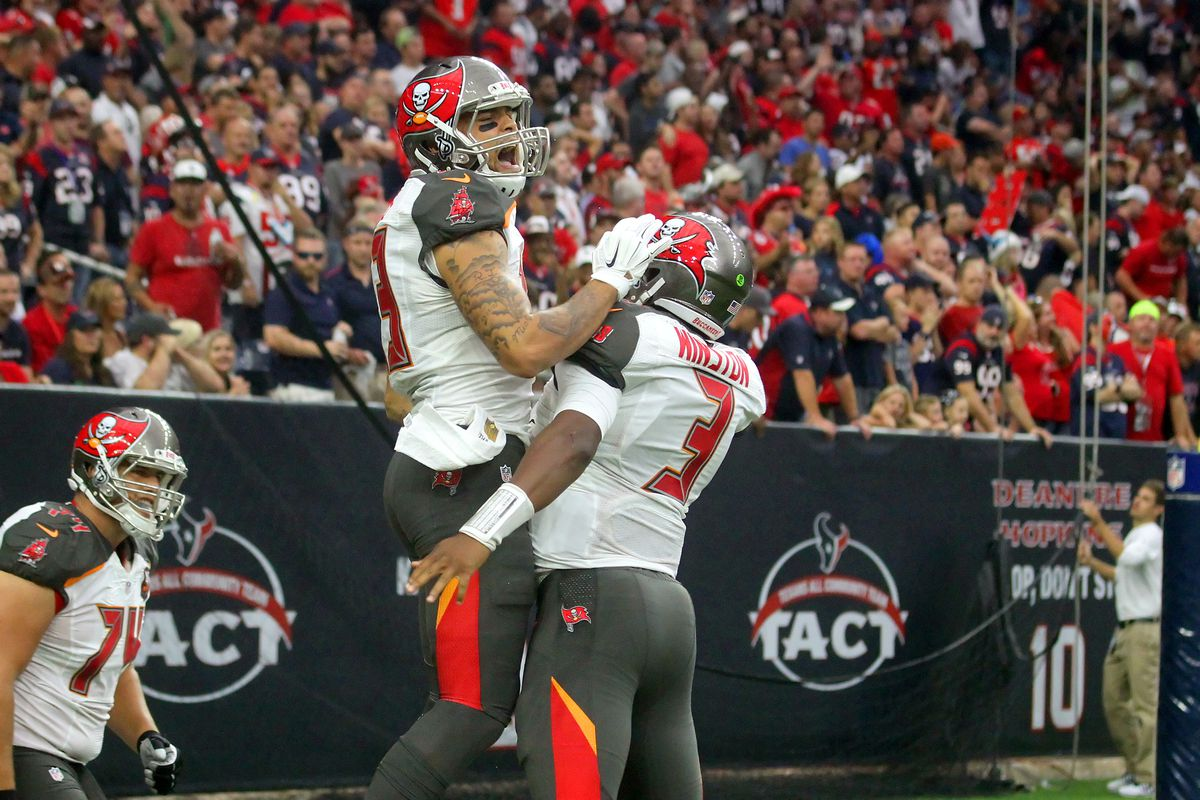 Mike Evans of the Buccaneers and quarterback Jameis Winston celebrate Charles Sims's touchdown during the regular season game between the Tampa Bay Buccaneers and the Houston Texans at NRG Stadium in Houston, TX.