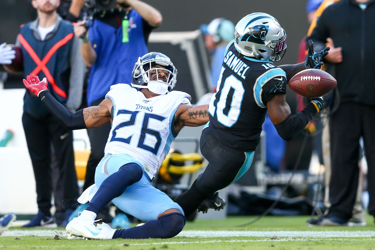 Carolina Panthers wide receiver Curtis Samuel attempts to catch a pass against Carolina Panthers cornerback Donte Jackson during the third quarter at Bank of America Stadium.
