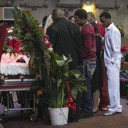 """Family members mourn during the funeral services for 55-year-old Bettie Jones, who was """"accidentally"""" shot to death by a Chicago Police officer the day after Christmas, at New Mount Pilgrim Missionary Baptist Church on Wednesday, Jan. 6, 2016."""
