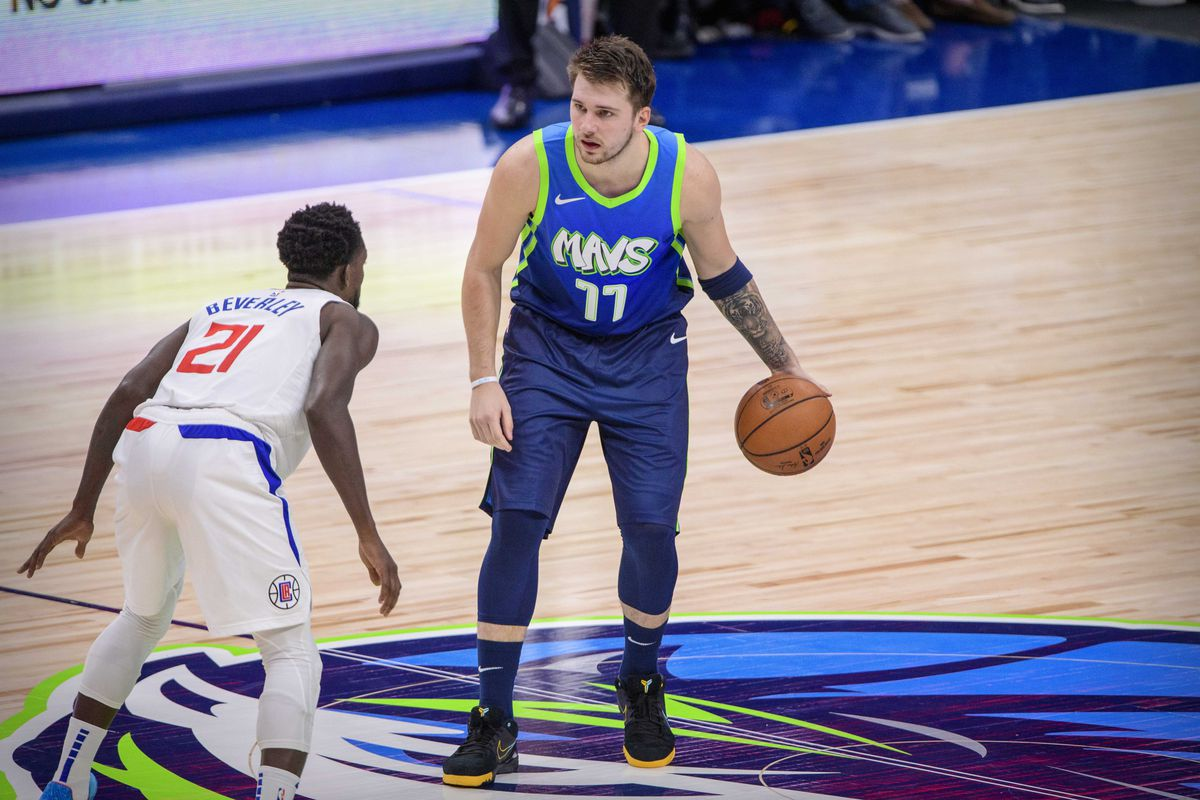 LA Clippers guard Patrick Beverley and Dallas Mavericks forward Luka Doncic in action during the game between the Mavericks and the Clippers at the American Airlines Center.