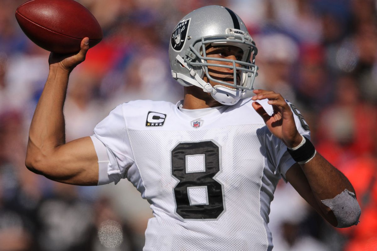 ORCHARD PARK, NY - SEPTEMBER 18: Jason Campbell #8 of the Oakland Raiders throws a pass during an NFL game against the Buffalo Bills at Ralph Wilson Stadium on September 18, 2011 in Orchard Park, New York. (Photo by Tom Szczerbowski/Getty Images)