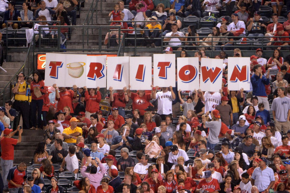 """Jul 6, 2012; Anaheim, CA, USA; Fans of Los Angeles Angels right fielder Torii Hunter (not pictured) spell out """"Toriitown"""" duirng the game against the Baltimore Orioles at Angel Stadium. Mandatory Credit: Kirby Lee/Image of Sport-US PRESSWIRE"""