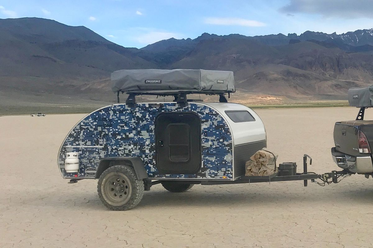 Teardrop camper trailer uses a rooftop tent to sleep a family - Curbed