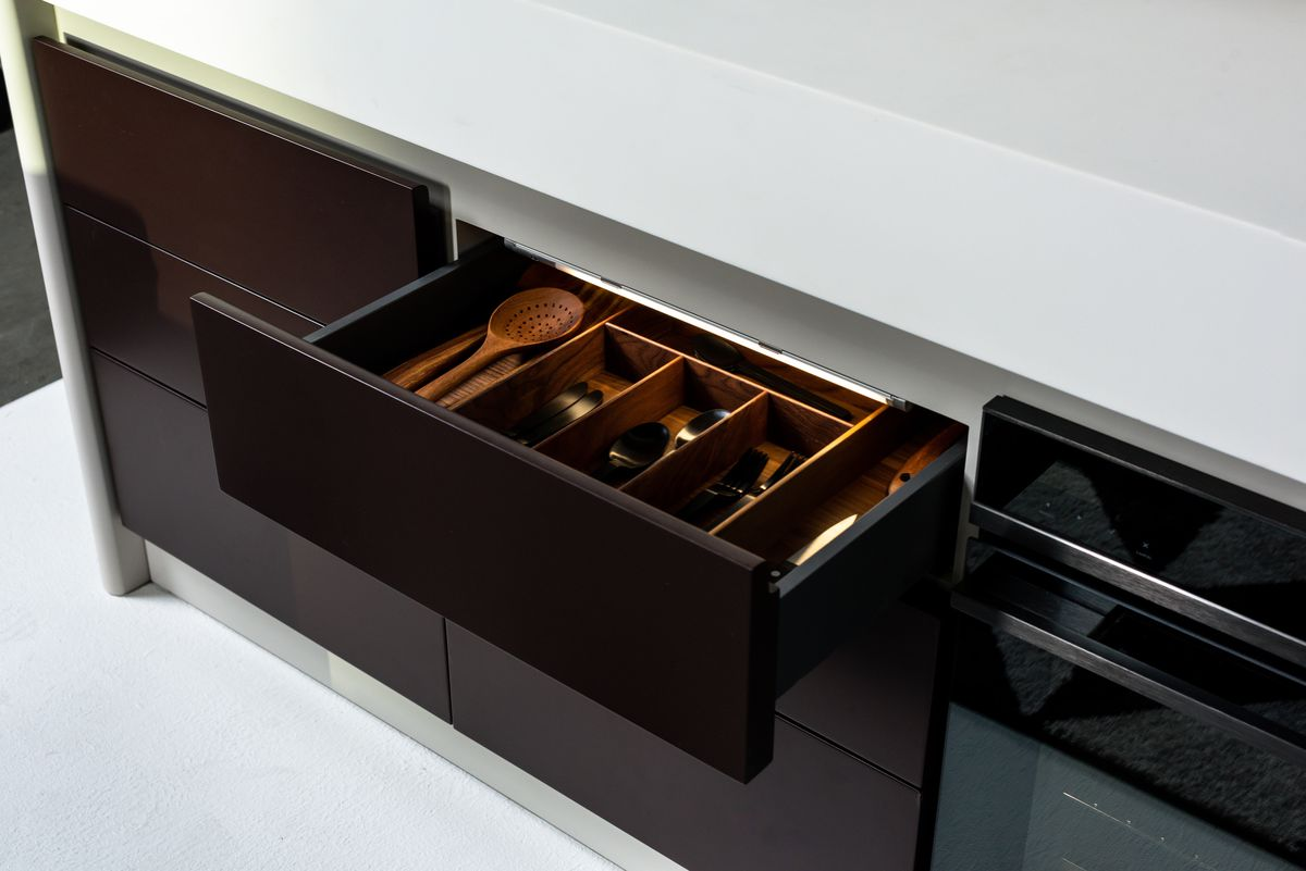 Silverware drawer filled with utensils