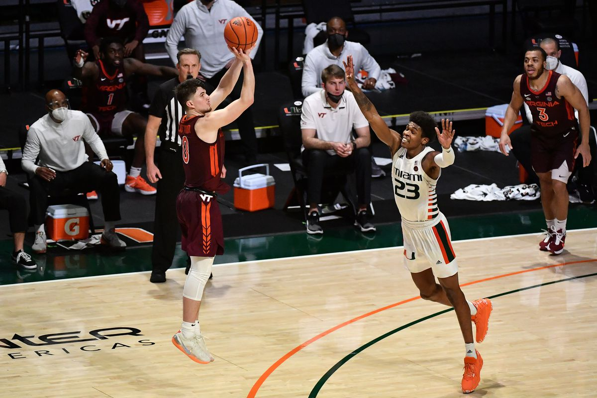 Virginia Tech Hokies guard Hunter Cattoor attempts a three point shot over Miami Hurricanes guard Kameron McGusty during during overtime at Watsco Center.