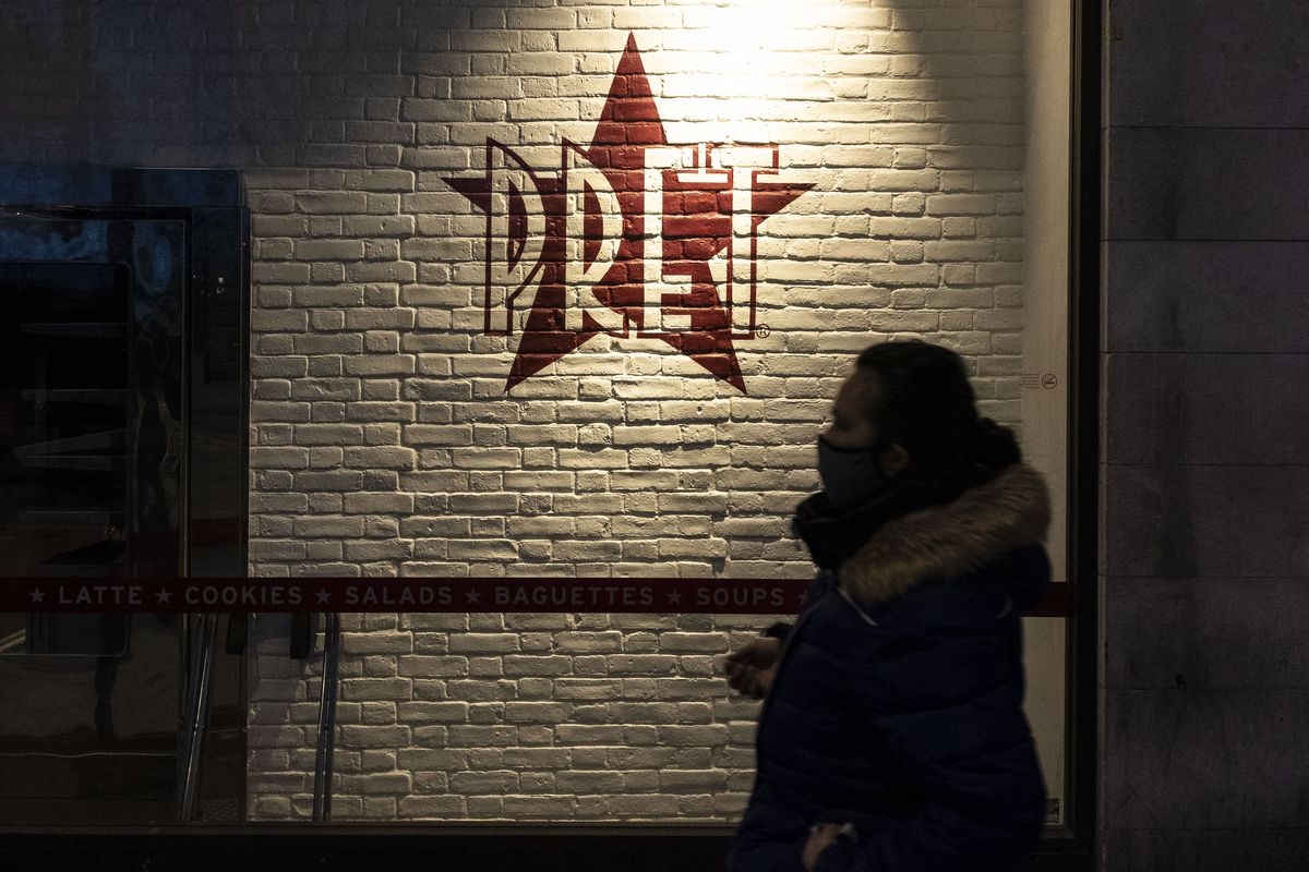A man walking past the Pret café stores in London, during the Covid-19 pandemic