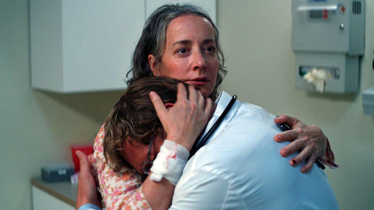 A bloodied Jane Adams comforts a weeping Josh Lucas in Amy Seimetz' film She Dies Tomorrow.