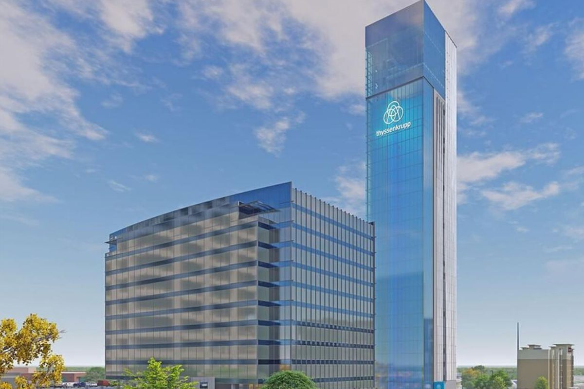 A rendering shows a simple, glassy blue tower standing behind a bulky office stack.