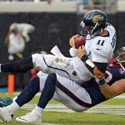 Jacksonville Jaguars quarterback Blaine Gabbert (11) is sacked by Houston Texans outside linebacker Brooks Reed (58) during the first half of an NFL football game, Sunday, Sept. 16, 2012, in Jacksonville, Fla.