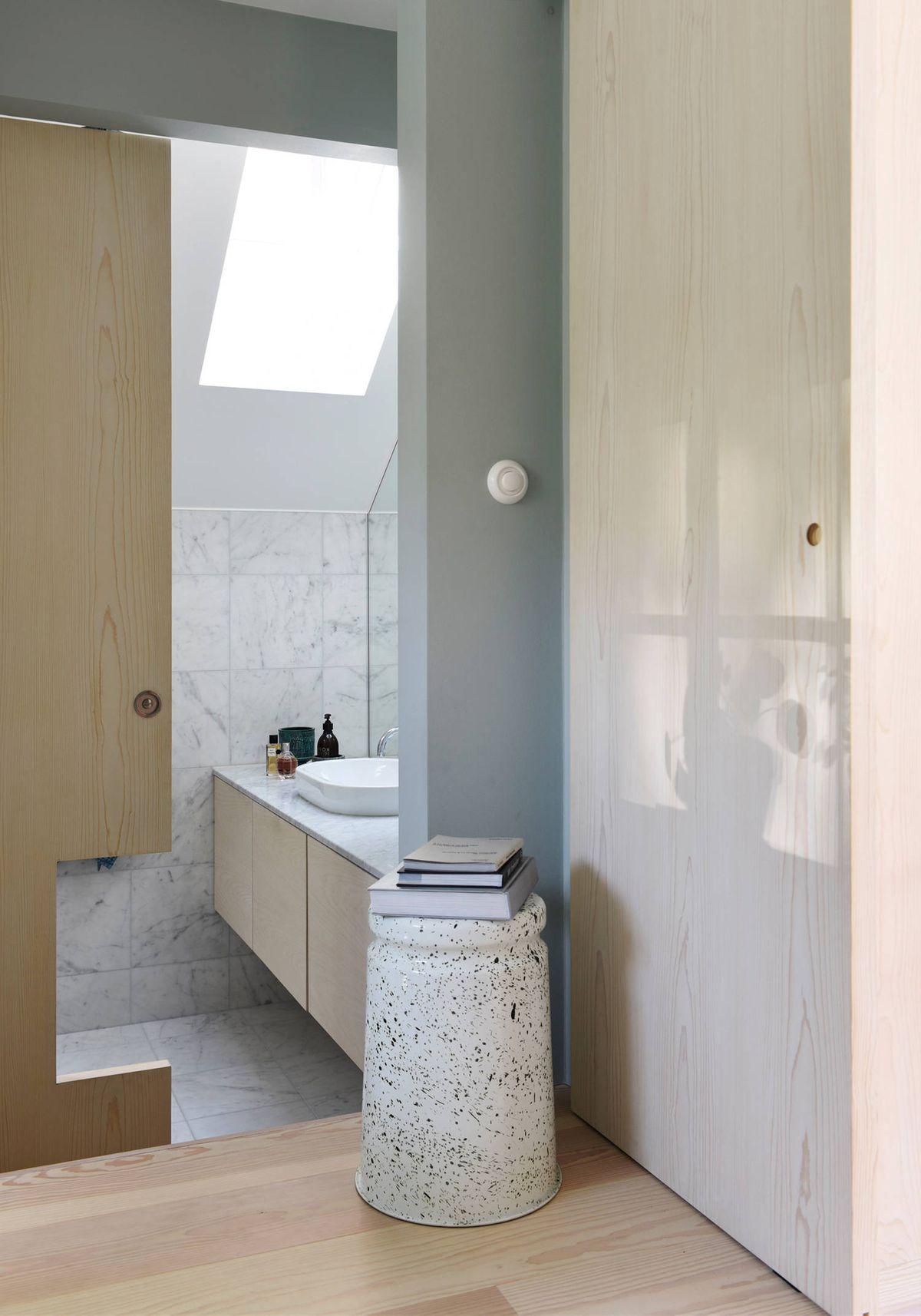 Bathroom with sliding door half open
