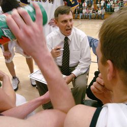 During a timeout, Snow College coach Roger Reid goes over plays with his basketball team in Ephraim, Jan. 28, 2006.