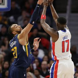 Utah Jazz center Rudy Gobert (27) defends against a shot by Detroit Pistons forward Tony Snell (17) during the second half of an NBA basketball game Saturday, March 7, 2020, in Detroit.