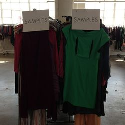 Two racks of incredible dress, knits and top samples in small sizes.