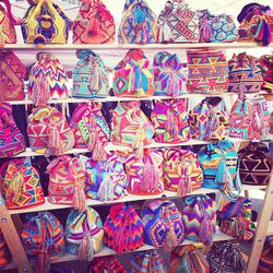 """This was <a href=""""http://wayuutribe.com/""""target=""""_blank"""">Wayuu Tribe</a>'s very first flea market. All bags are handmade by an indigenous tribe in South America."""