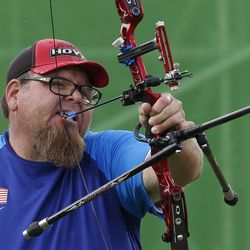 United States' Eric Bennett uses his mouth to pull back his arrow, as he competes in the individual recurve open archery event at the Paralympic Games at the Sambadrome in Rio de Janeiro, Brazil, Tuesday, Sept. 13, 2016.