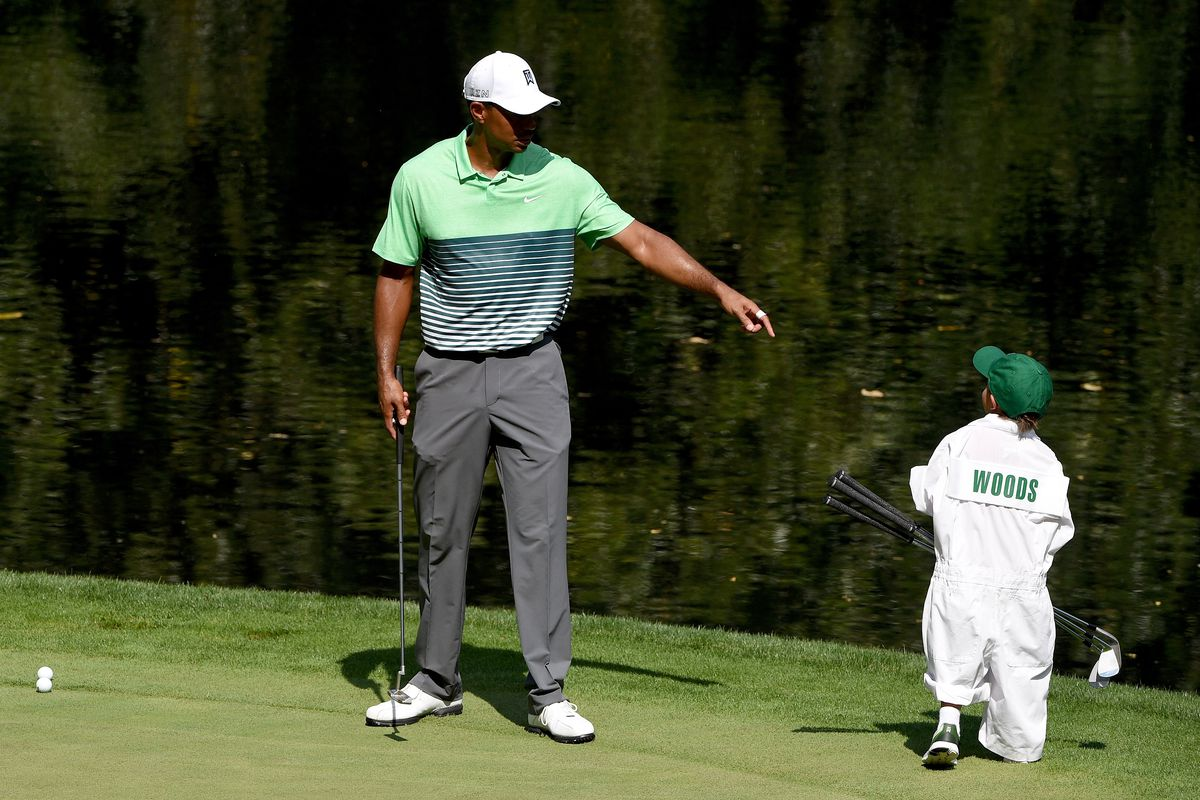 Tiger Woods of the United States with his son Charlie during the par three contest prior to the start of the 2015 Masters Tournament at Augusta National Golf Club on April 8, 2015 in Augusta, Georgia.