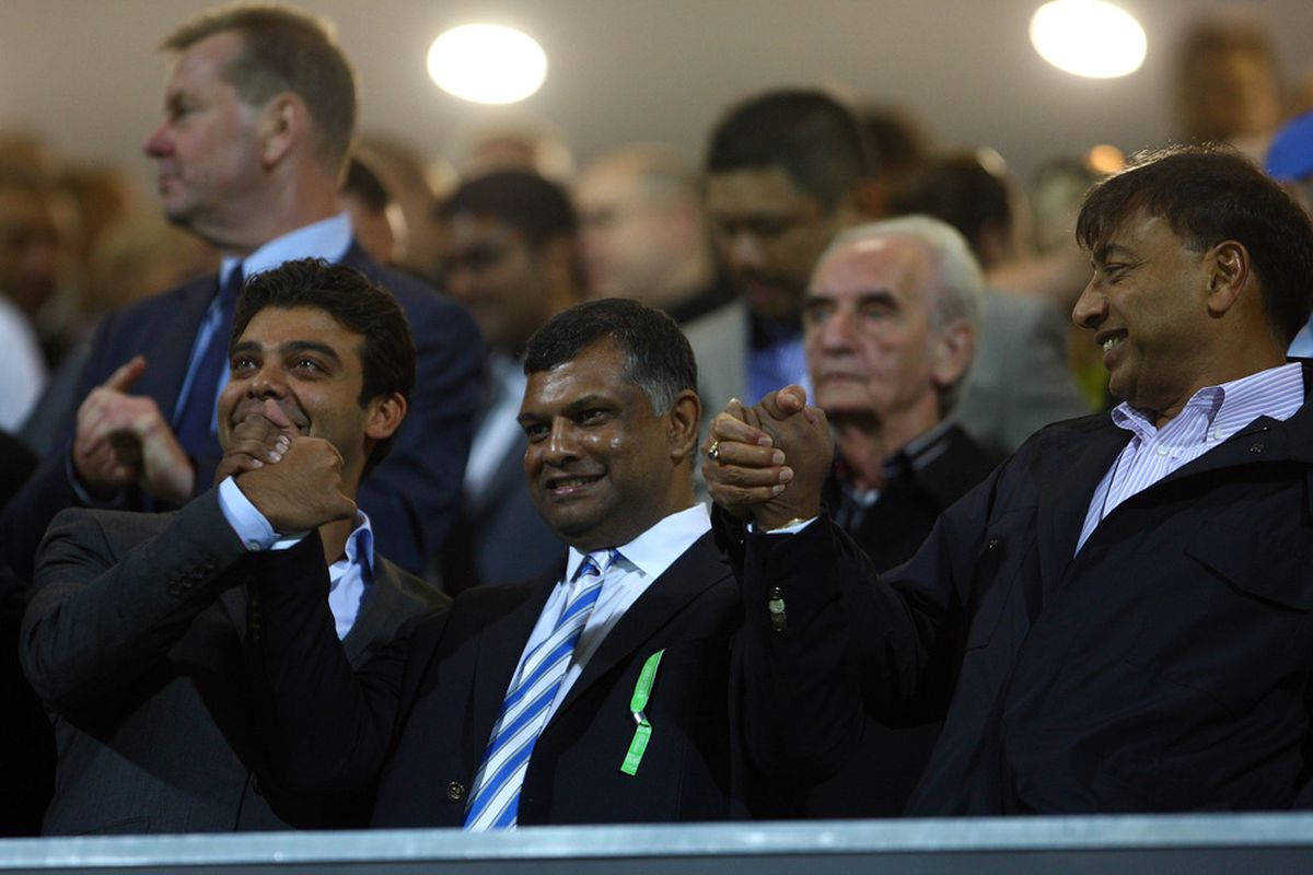 QPR Owner Tony Fernandes and chums laughing all the way to the bank.  (Photo by Julian Finney/Getty Images)