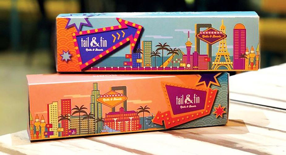 Sushi roll boxes designed with the Las Vegas skyline, available at Tail & Fin.