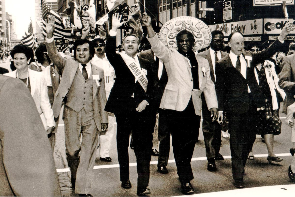 María Cerda (left) marching in a Mexican Independence Day parade with Mayor Harold Washington (wearing the sombrero). Her husband David Cerda (wearing the sash as the parade's grand marshal) walked next to Washington.
