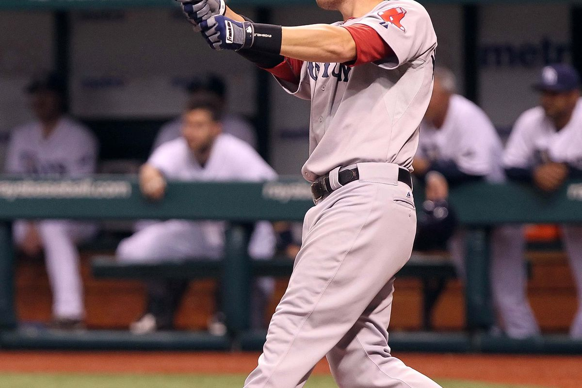 July 14, 2012; St. Petersburg, FL, USA; Boston Red Sox third baseman Will Middlebrooks (64) hits a 2-run home run in the fourth inning against the Tampa Bay Rays at Tropicana Field. Mandatory Credit: Kim Klement-US PRESSWIRE