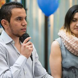 Manuel Rameriz, left, talks about receiving a kidney donation from his friend Cynthia Martinez, right, at a ceremony hosted by Intermountain Donor Services in Salt Lake City on Wednesday, Dec. 21, 2016.