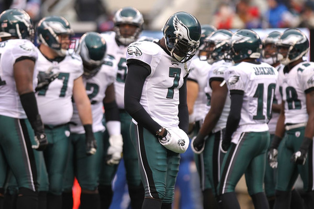 EAST RUTHERFORD NJ - DECEMBER 19:  Michael Vick #7 of the Philadelphia Eagles stands by the huddle against the New York Giants at New Meadowlands Stadium on December 19 2010 in East Rutherford New Jersey.  (Photo by Nick Laham/Getty Images)