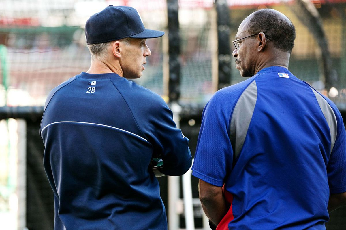 Apr 24, 2012; Arlington, TX, USA; New York Yankees manager Joe Girardi (left) speaks with Texas Rangers manager Ron Washington (right) before the game at Rangers Ballpark.  Mandatory Credit: Kevin Jairaj-US PRESSWIRE