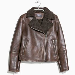 "<b>Mango</b>, <a href=""http://shop.mango.com/US/p0/women/clothing/jackets/shearling-lined-leather-jacket/?id=33055599_06&n=1&s=prendas.chaquetas&ident=0_color14_0_1412276656686&ts=1412276656686"">$290</a>"