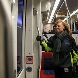 Donna Spangler, communications director for the Utah Department of Environmental Quality, makes her way to work via TRAX and FrontRunner in Salt Lake City on Thursday, Jan. 12, 2017. When not riding public transit to work from her home in Ogden, Spangler drives a hybrid car and avoids rush-hour commuting to minimize her emissions output.