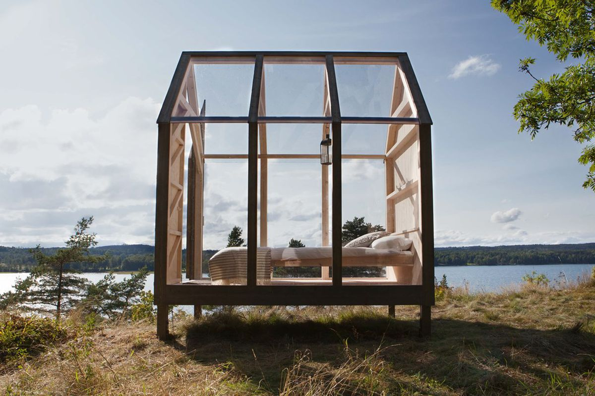 tiny glass cabin in nature