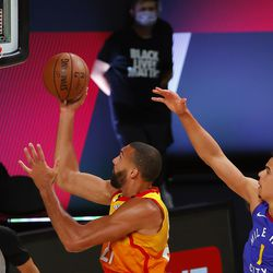 Utah Jazz' Rudy Gobert drives to the basket as Denver Nuggets' Michael Porter Jr., right, defends during the first quarter of an NBA basketball game Saturday, Aug. 8, 2020, in Lake Buena Vista, Fla.