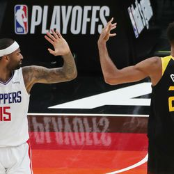 LA Clippers center DeMarcus Cousins (15) and Utah Jazz center Rudy Gobert (27) complain to the ref during the NBA playoffs in Salt Lake City on Thursday, June 10, 2021. The Jazz won 117-111.