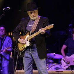 Merle Haggard, center, performs with Vince Gill, left, and Keith Urban, right, during the All for the Hall concert on Tuesday, April 10, 2012, in Nashville, Tenn. The concert is a benefit for the Country Music Hall of Fame and Museum.
