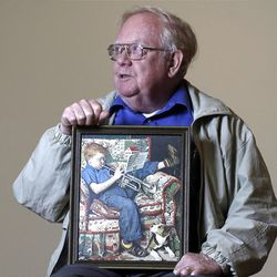 Tom Paquin poses for a photo with a 1950 Saturday Evening Post illustration by Norman Rockwell for which he modeled as a boy as he met with other models to reminisce.