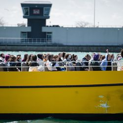 Students ride a boat on Lake Michigan near Navy Pier on its reopening day, Friday morning, April 30, 2021. Navy Pier was closed in 2020 due to the COVID-19 pandemic.